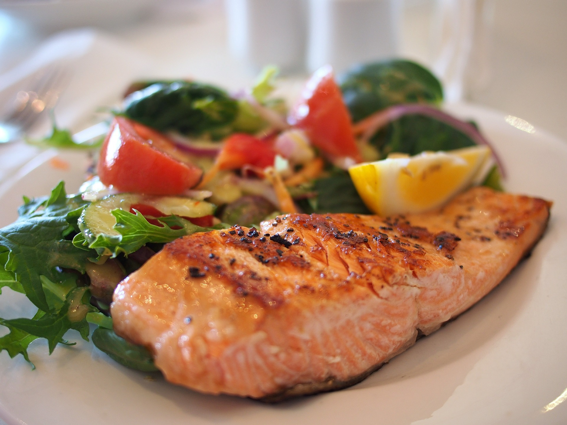 Salmon and salad: a low-carb, pescetarian, diabetes-friendly meal.