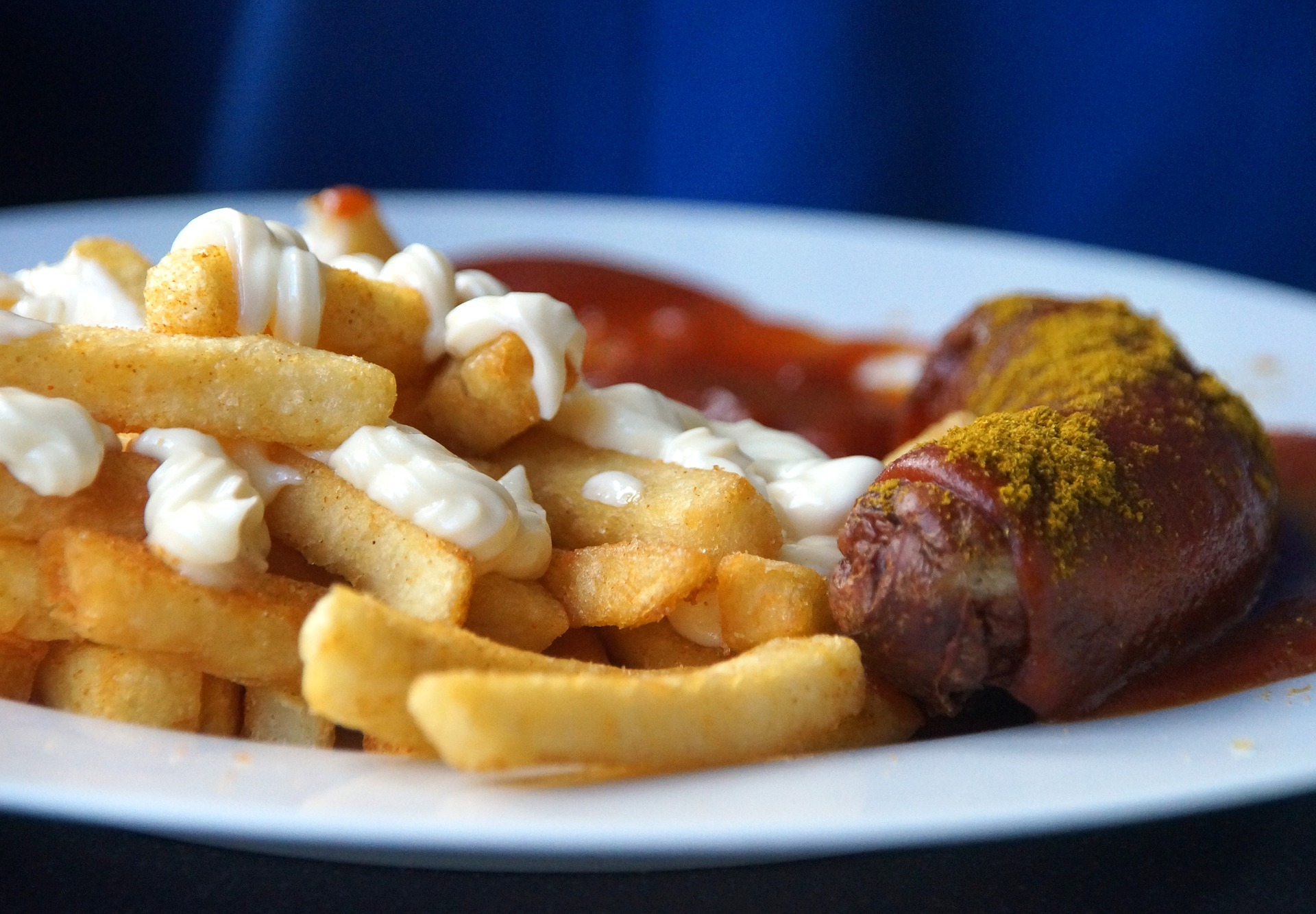 Sausage, fries, ketchup, and mayo - a high carb meal.